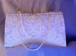 """Felicity Purse Lilac and Pearl 7"""" x 4"""" x 3.5"""" $35.00"""