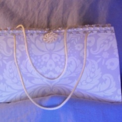 "Felicity Purse Lilac and Pearl 7"" x 4"" x 3.5"" $35.00"